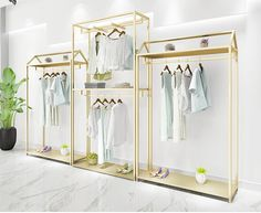 Golden clothes shelf clothing store in the island frame double sided women's clothing store bag display rack floor double row. Bag Display, Display Shelves, Wall Shelves, Hanging Clothes Racks, Clothes Shelves, Womens Clothing Stores, Clothes For Women, Women's Clothing, Clothing Store Displays