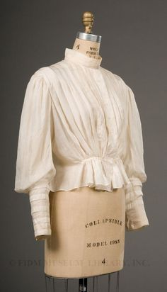 The shirtwaist first emerged in the 1860s as a casual, daytime alternative to the matched bodice and skirt ensembles worn by nearly all well-dress women. Most frequently worn by young women, the shirtwaist was usually paired with a dark colored skirt and accessorized with a belt or sash. The Garibaldi, a high-necked, long sleeved shirtwaist styled to resemble the uniforms worn by the troops of celebrated Italian hero Guiseppe Garibaldi, was the first style of feminine shirtwaist to become…
