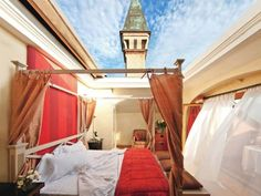 At the L'albereta (Photo: Stefano Scata) in Lombardy, Italy you can stay in a suite where you can press a button and the roof above the bed opens so you can sleep under the open sky.