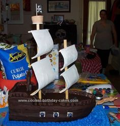 Homemade Pirate Ship Birthday Cake: I made this Pirate Ship Birthday Cake for my son's first birthday party.  We made the whole party pirate-themed!  His smash cake was a treasure chest.