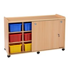 Storage Unit with Sliding Doors - 12 Coloured Tubs - This storage unit with doors and clear plastic tubs is part of a range that sets the standard in terms of quality, safety and design and as far as practicality eliminates any protruding corners, whilst further enhancing the usability of the items by creating recessed unit top play areas making this range the perfect classroom furniture range.