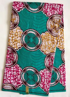 A personal favorite from my Etsy shop https://www.etsy.com/listing/497675839/african-print-fabric-ankara-green-dark
