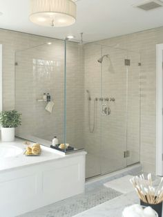 Bathroom shower stall - love the lightness of the shower tiles and really enjoy the drumshade light fixture.