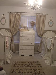 Serene Nursery for Twins: I didn't want anything themey, nothing busy. I wanted a magical french-inspired ivory nursery with touches of pink and blue. I painted using Behr Toasted