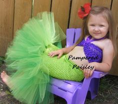 Baby Petti Tutu Dress The bodice is purple with a purple halter top. The skirt is a lime green crochet top with a triple layered green tutu.