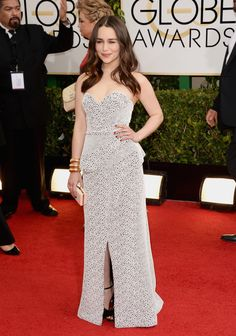 Emilia Clarke at the Golden Globes 2014: The presenter accentuated her curves in a contoured Proenza Schouler gown that featured a graphic black and white print. Bold gold Sidney Garber cuffs added extra drama to the design.