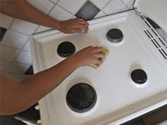 Clean stove top using baking soda and salt to absorb the grease, not cut it and as a mild abrasive.  Keep away from actual burners.  Worked great at absorbing grease, but needed water and vinegar to fully wipe up the powder.  So burners got wet.  One still not working after an hour.