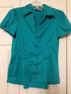Turquoise size small short sleeve button down top. Came with a belt I don't have anymore. Only worn a few times. $12 shipped