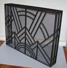 French Art Deco hand forged iron fire screen - Charles Piguet 1925 | From a unique collection of antique and modern fireplace tools and chimney pots at http://www.1stdibs.com/furniture/building-garden/fireplace-tools-chimney-pots/