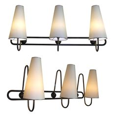 Two 1950s Sconces by Jean Royere   From a unique collection of antique and modern wall lights and sconces at http://www.1stdibs.com/furniture/lighting/sconces-wall-lights/