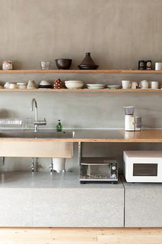Interesting idea, putting appliances that would usually be on top of the counter right below:   Concrete kitchen