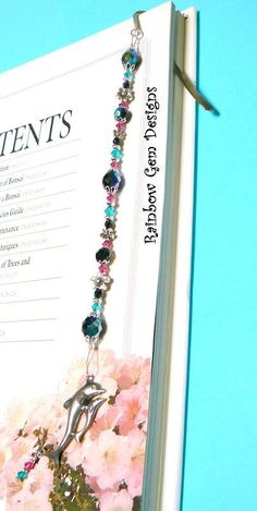 Gorgeous Czech Jet AB Bead, Swarovski Blue Zircon and Fuchsia Crystal Silver Bookmark with Pewter Dolphin Charm and Crystal Dangle    By
