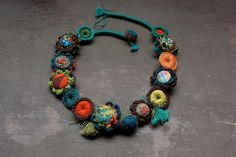 Crochet, embroidered necklace, fiber jewelry with fabric buttons and felt beads, brown orange blue teal, OOAK