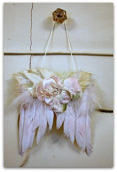 Cherub wings with velvet millinery