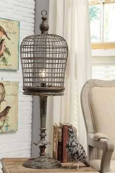 birdcage and old wooden lamp base?