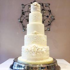 Ivory and white roses.  Elegant wedding cake with brush embroidery.
