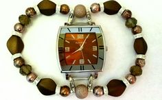 Brown watch face with various brown and beige beads