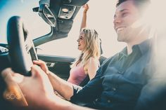 Couple on convertible car - Couple of lovers driving on a convertible car - Newlywed pair on a romantic date