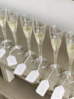Champagne with your escort cards...yes please! http://www.stylemepretty.com/2017/01/06/a-wildly-beautiful-garden-wedding-in-the-middle-of-the-city/ Photography: Lauren Fair - http://laurenfairphotography.com/