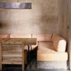 Soft colours and banquette cushions.