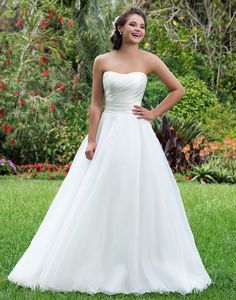 Sweetheart Gowns sweetheart style 6115  Strapless organza ball gown with ruched satin bodice and cummerbund that creates a figure flattering silhouette. This charming gown can be accessorized to your liking.