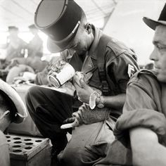 A French soldier taking a break to feed a kitten in Indochina, 1956