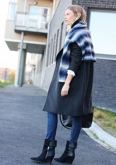 drape a chunky knit sweater over your outerwear via @WhoWhatWear