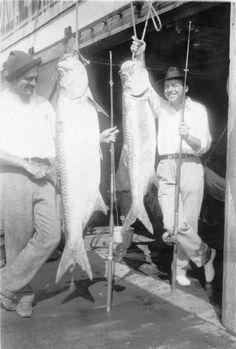 Ernest Hemingway and John Dos Passos pose with two tarpon fish, Key West, Florida, 1928.