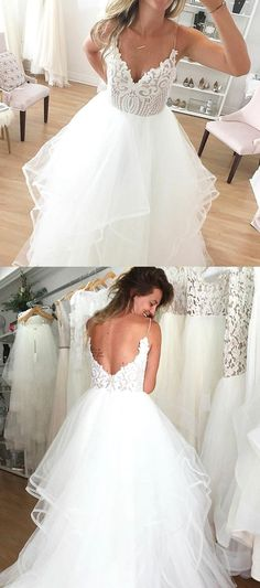 White wedding dress. All brides think of finding the perfect wedding, but for this they need the perfect wedding outfit, with the bridesmaid's outfits actually complimenting the brides dress. These are a number of ideas on wedding dresses.