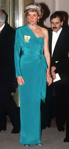 a full length image, with the teal gown and emerald choker