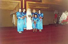 27 Of The Most Amazing '80s Weddings You'll Ever See - just from looking at these pics it seems blue bridesmaids (various shade from pale to dark or blue/green) were the most popular,closely followed by various shade of pink, then peach and yellow.  Shiny satin seems the most popular material, with puffy sleeves a must.  Wide brimmed hats were quite popular as are headbands and lacy gloves.