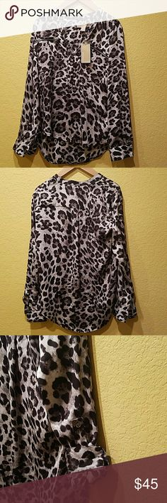 Michael's Kors Top NWT Adorable print blouse that can be paired with leggings. Michael Kors Tops Tunics