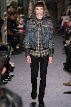 Valentino revisits the denim jacket, adding its signature embellishments.