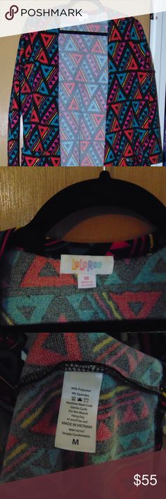 Lularoe Sarah M Worn Once Triangle Thicker material Red Yellow Pink Turquoise with Black background Like New  Only worn once LuLaRoe Sweaters