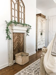A tutorial on how we made a vintage-inspired faux fireplace mantle with a herringbone insert House, Christmas Fireplace Decor, Home, Faux Fireplace Mantels, Bedroom Fireplace, Faux Fireplace Diy Cardboard, Farmhouse Mantle, New Homes, Fireplace