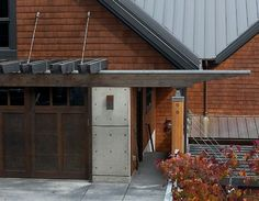 contemporary suspended trellis over garage detail - Dan Nelson A.I.A. Designs Northwest Architects