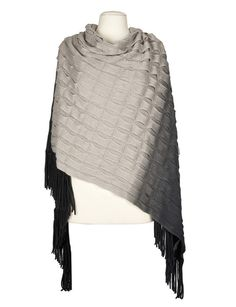 A tiered ombre knit poncho that will keep you cosy in the colder weather.