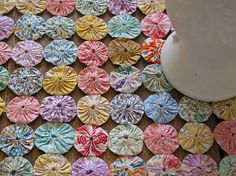 Love yo-yo quilts.  This site has lots of ideas.