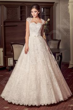 This enchanting wedding gown will cover you in the essence of a blooming flower garden.  Its unique cut amplifies your figure in all the right places. The cut-out on the back adds an alluring touch, and the lace cap sleeves accentuate your neck and décolletage. The wide skirt with a lace overlay is weightless and romantic, and the thin satin belt with a bow adds an elegant finishing touch.  Let your natural beauty shine through in this one-of-a-kind gown.  *The price doesn't...