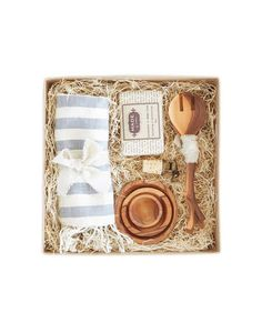 - Description A gift set to help new homeowners settle into their nest! This box includes a striped hand towel, lavender and honey soap, 3 olive wood condiment bowls, a set of small olive branch serve