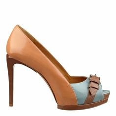 """A classic peep toe design set on a slight platform. The icing on the cake? The buckle detail across the toe. Perfection! Padded footbed for all-day comfort. Leather upper. Man-made lining and sole. Imported. 1"""" platform. 4 1/4"""" heels. Peep toe pumps."""