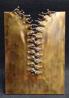ZIP bronze sculpture.