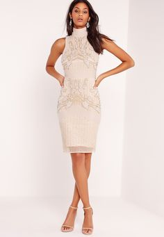 Premium, baby! We're going all out on this one! Embellishment is everywhere at the moment and this sparkling midi will vamp up any event or occasion. Lust over its figure-flattering bodycon style, on trend high neck, and gold, white and sil...