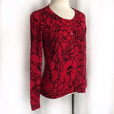 "Rafaella Red and Black Cardigan Graphic floral print cardigan from Rafaella. Seven button cardi with long sleeves and fine rib hem and cuffs. 100 % cotton. Hand wash. Size Medium. Bust: 16.5"".  Waist: 16"".  Length: 22"".  Shoulder to shoulder: 14"". EUC. Thanks for looking! Rafaella Sweaters Cardigans"