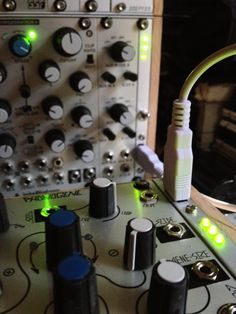 My home setup.  Home made wooden enclosures for my Eurorack modular synth.  Closeup showing completed custom made power panels, connecting multiple cases together.
