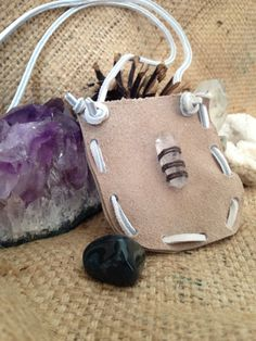 Leather satchel necklace with quartz crystal by thisthatandthese, $15.00