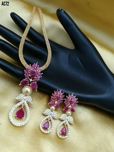 Beautiful chocker with lotus design pendent. Pair of ear rings with lotus design and studded with white pink color CZS. 14 August 2017