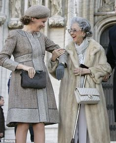 Queen Fabiola and Princess Mathilde leave the Saint-Gudule cathedral at the end of a Te Deum religious service in November 2007