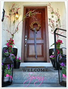 Create a Welcoming Spring Entry with painted pots + colorful plants + add interest with lanterns from HomeGoods! #HomeGoodsHappy #HappyByDesign #sponsored