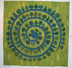 Round Forest, designed by Gyöngyi Váradi and made by the Hungarian Quilt Guild. Photograph courtesy of Sarah Fielke art quilt green aqua teal turquoise